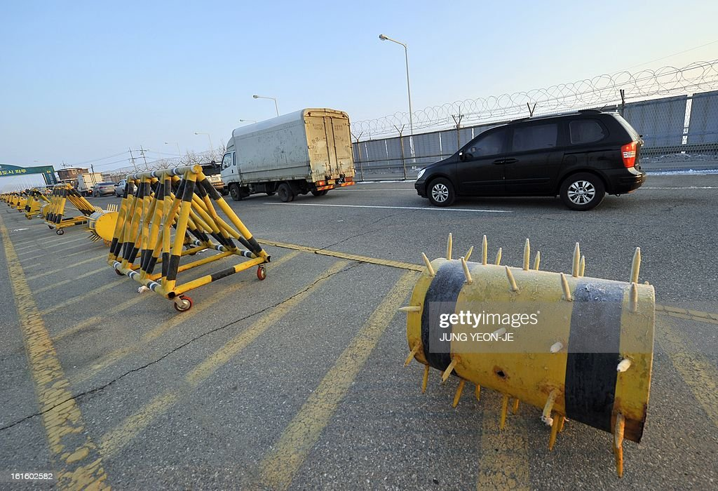 South Korean vehicles drive past barricades to leave for North Korea's Kaesong Industrial Complex at a military check point in Paju near the demilitarized zone dividing the two Koreas on February 13, 2013. North Korea on February 12 staged its most powerful nuclear test yet and warned of 'stronger' action to follow if the ensuing wave of global condemnation translated into tougher sanctions.