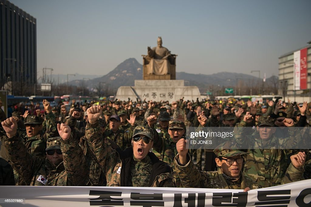 South Korean veterans against North Korea hold a rally in Seoul on March 6, 2015. AFP PHOTO / Ed Jones