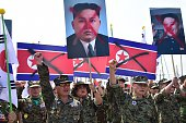 South Korean veterans hold placards showing spraypainted portraits of North Korean leader Kim JongUn during an antiNorth Korea protest in Paju on...