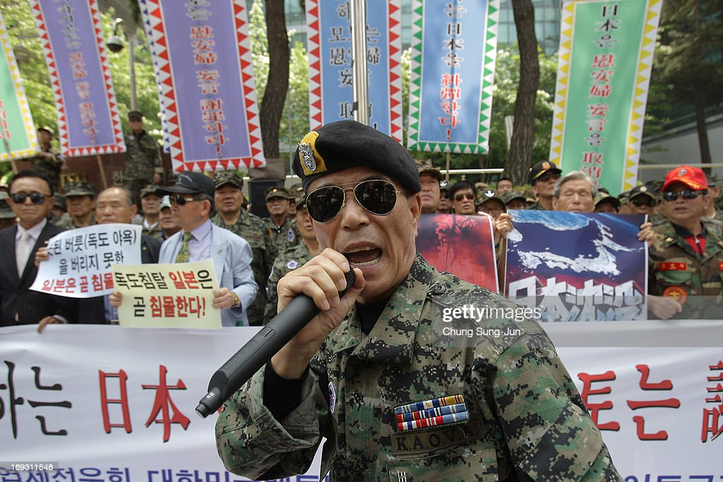 South Korean Vietnam War veterans shout slogans during a rally in front of Japanese embassy on May 23, 2013 in Seoul, South Korea. Recent remarks by the mayor of Osaka on the historic perception of 'comfort women', conscripted by Japanese military brothels during World War II, have recieved intense criticism from neigbouring countries and the US.