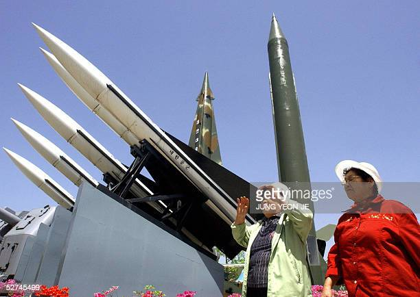 South Korean visitors walk by displays of North Korea's ScudB missile and other South Korean missiles at the Korea War Memorial Museum in Seoul 02...