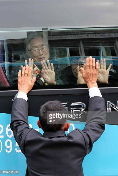 South Korean woman Lee GeumSeok cries as she bids farewell through the window to her North Korean son Han SongIl after a threeday family reunion...