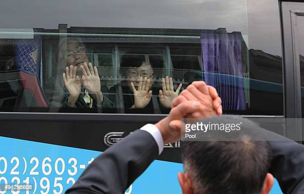 South Korean woman Lee GeumSeok cries as she bids farewell through the window to her North Korean son Han SongIl before they return to their home...