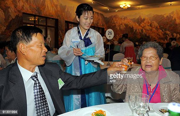 South Korean woman Moon HyunSoo makes a toast with her North Korean relative during their reunion at North Korea's Mount Kumgang resort near the...