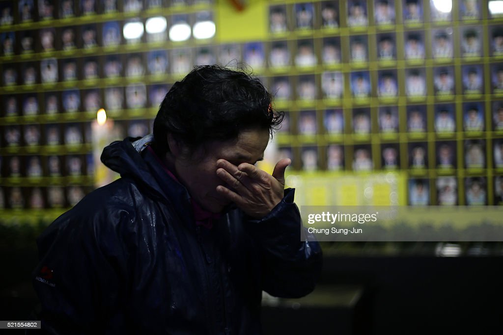 South Korean woman pays tribute at a group memorial altar for victims of the sunken ferry Sewol during the second anniversary of the Sewol disaster...