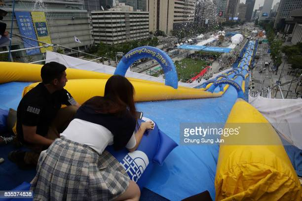South Korean woman slides down on an inflatable bobsleigh during the 'Bobsleigh In the City' on August 19 2017 in Seoul South Korea The 22metrehigh...