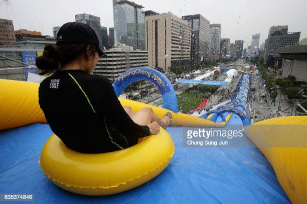 South Korean woman slides down on an inflatable ring during the 'Bobsleigh In the City' on August 19 2017 in Seoul South Korea The 22metrehigh...