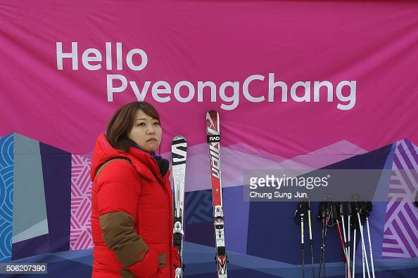 South Korean woman stands in front of a banner during the venue opening ceremony for the forthcoming official Test Event of the Pyeongchang 2018...