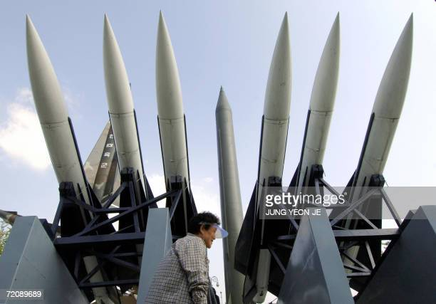 South Korean woman walks by displays of North Korea's ScudB missile and other South Korean missiles at the Korea War Memorial Museum in Seoul 05...