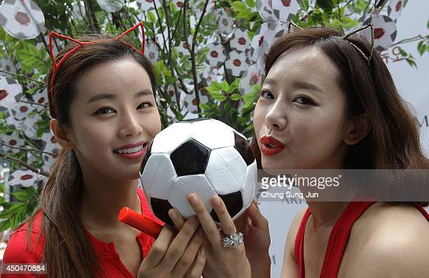 South Korean women kiss the soccer ball during an event wishing for South Korean team's success in the 2014 FIFA World Cup Brazil on June 12 2014 in...