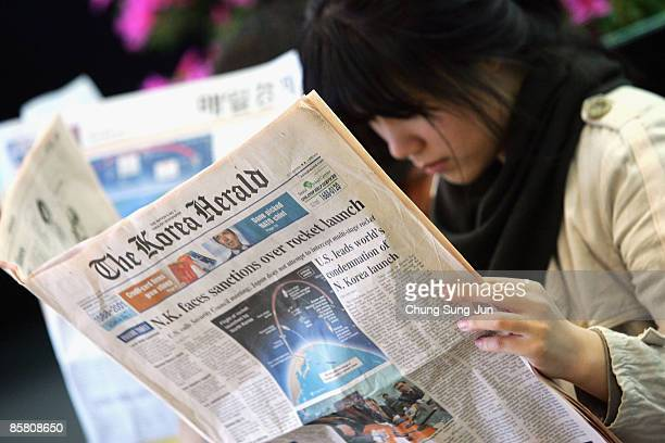South Korean women reads a newspaper reporting North Korea's rocket on April 5 in Seoul South Korea The first stage of the long range rocket fell...