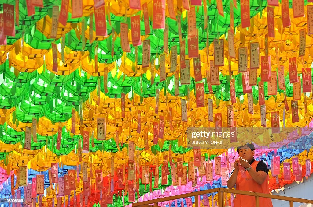A South Korean worker attaches name cards with wishes of Buddhist followers to lotus lanterns during a ceremony to celebrate the birthday of Buddha at Jogye temple in Seoul on May 17, 2013. Buddhism is one of South Korea's largest and most active religions with millions of followers. Although the exact date is unknown, Buddha's official birthday is celebrated on April 8th of the lunar calendar in South Korea.