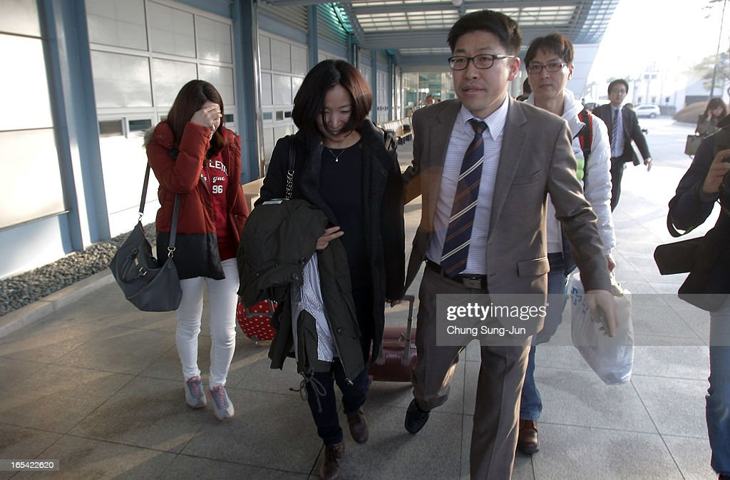 South Korean workers arrive from the Kaesong joint industrial complex in North Korea at the inter-Korean transit office on April 4, 2013 in Paju, South Korea. 400 South Koreans remain in the joint industrial complex fearing they can not get back there once return to South. In recent weeks North Korea have threatened to attack South Korea and U.S. military bases.