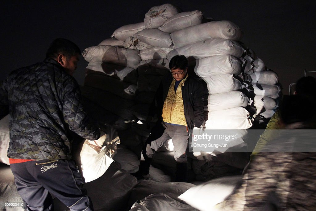South Korean workers unload their products made in North Korea after they arrive from the Kaesong joint industrial complex in North Korea at the inter-Korean transit office on February 11, 2016 in Paju, South Korea. South Korea announced on February 10, 2016 that the country would close an industrial complex jointly ran with North Korea, as the strongest response for North's recent nuclear test and rocket launch.