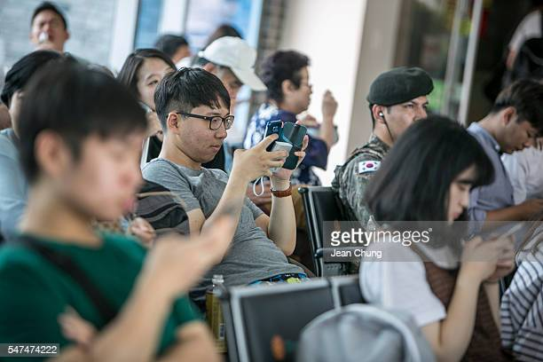 South Korean youths play Pokemon Go at the Express Bus Terminal on July 15 2016 in Sokcho South Korea South Korea is not one of the initial Pokemon...