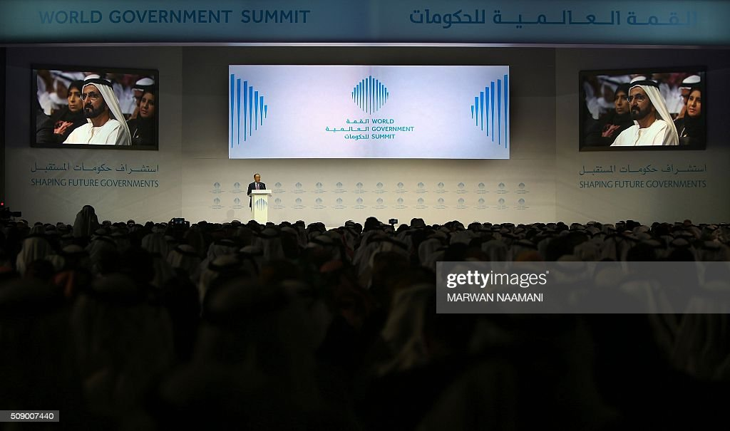 South Korean-American President of the World Bank Group, Jim Yong Kim gives a speech as Sheikh Mohammed bin Rashid al-Maktoum, UAE Prime Minister and ruler of Dubai is seen on giant screens, during the opening session of the World Government Summit on February 8, 2016 in Dubai. The World Government Summit is a forum of representatives from across the globe on shaping future governments. / AFP / MARWAN NAAMANI