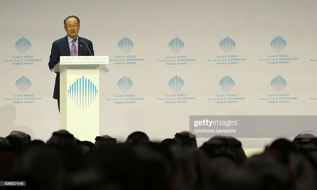 South Korean-American President of the World Bank Group, Jim Yong Kim gives a speech during the opening session of the World Government Summit on February 8, 2016 in Dubai. The World Government Summit is a forum of representatives from across the globe on shaping future governments. / AFP / MARWAN NAAMANI