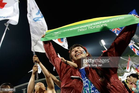 South Koreans celebrate being selected as 2018 Winter Olympic host city at Alpensia Resort on July 7 2011 in Pyeongchang South Korea Pyeongchang won...