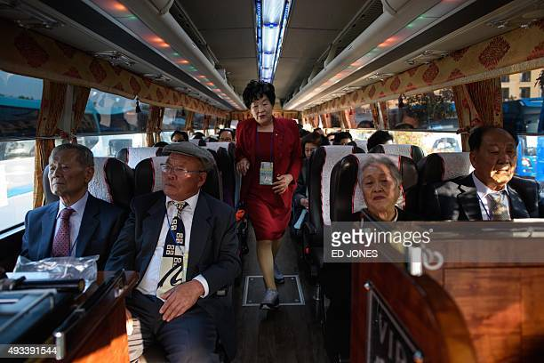 South Koreans chosen to attend a family reunion event with their North Korean relatives sit on a bus before departing for the border and...