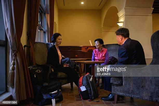 South Koreans chosen to attend a family reunion event with their North Korean relatives wait in the lobby before leaving their hotel for the border...