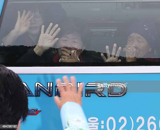 South Koreans cry as they bid farewell through the window to their North Korean relatives after a threeday family reunion event at North Korea's...