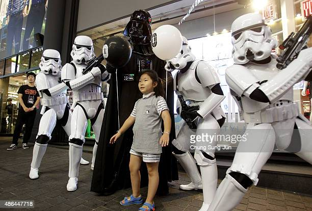South Koreans dressed in a Darth Vader and Stormtroopers during the 'Star Wars Force Friday' in Myeongdong shopping district on September 4 2015 in...