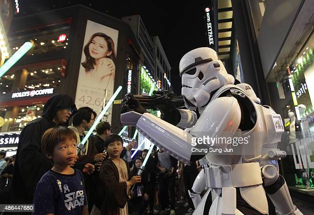 South Koreans dressed in a Stormtroopers during the 'Star Wars Force Friday' in Myeongdong shopping district on September 4 2015 in Seoul South Korea...