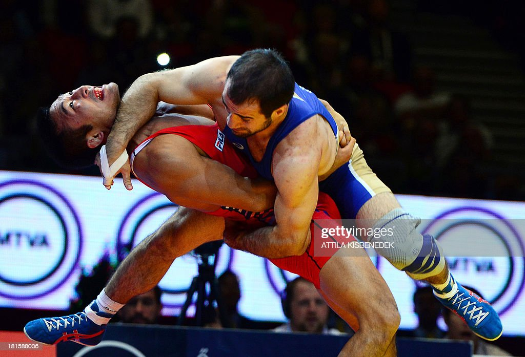 South Korean's HanSu Ryu and Russia's IslamBeka Albiev fight during the men's GrecoRoman style 66 kg category final of the FILA World Wrestling...