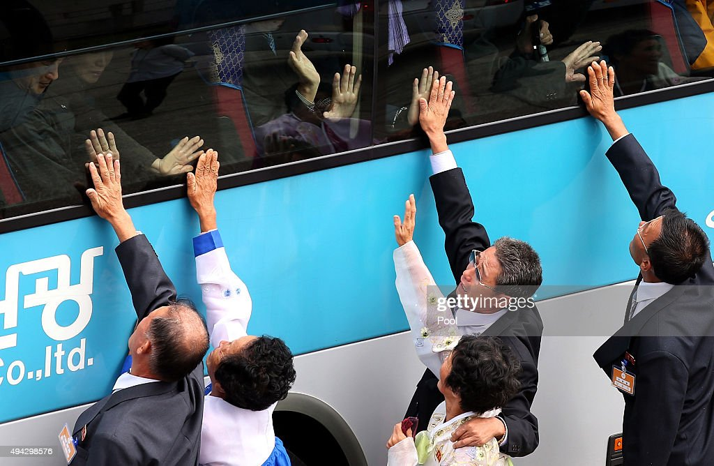 South Koreans in a bus bid farewell to their North Korean relatives before they return to their home after a family reunion having been separated for 60 years following the Korean War on October 26, 2015 in Mount Kumgang, North Korea. The program allows the reunions of family members separated by the 1950-53 Korean war.