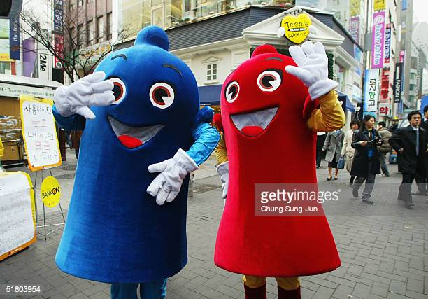 South Koreans in condom costume pose during a AIDS awareness campaign on November 30 2004 in Seoul South Korea More than 2500 people in South Korea...