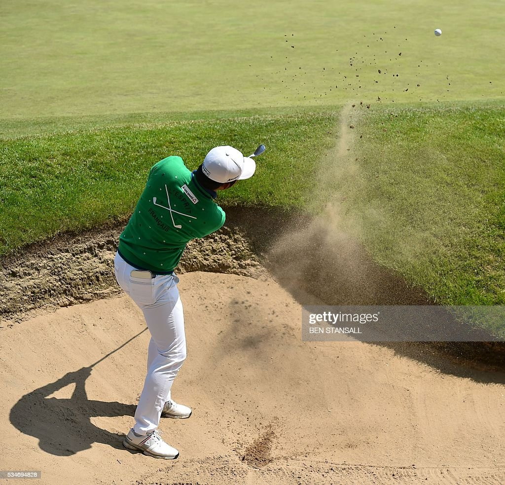 South Korean's Lee Soomin plays out of a bunker on the 18th hole during the second day of the PGA Championship at Wentworth Golf Club in Surrey, south west of London, on May 27, 2016. / AFP / BEN