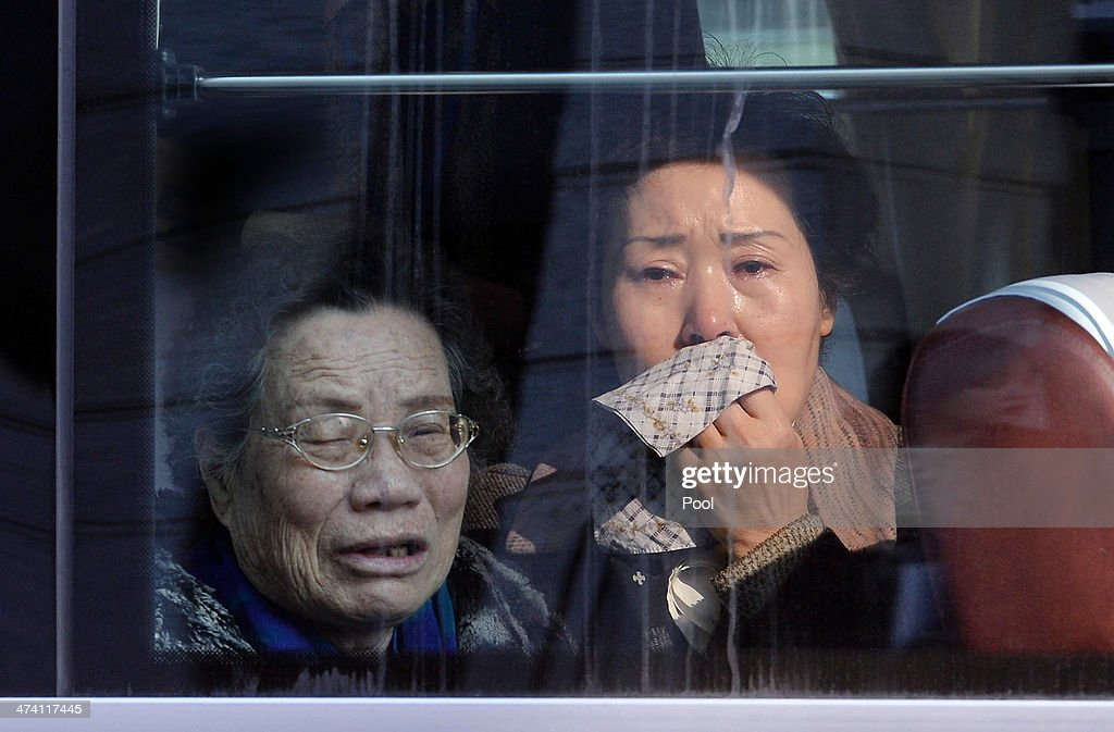 South Koreans on a bus bid farewell to their North Korean relatives before they return to their home after a family reunion having been separated for 60 years following the Korean War on February 22, 2014 in Mount Kumgang, North Korea. The program, which allows reunions of family members separated by the 1950-53 Korean war, is a result of recent agreement between North and South Korea which had been suspended since 2010.