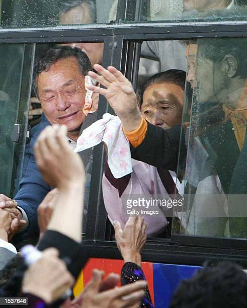 South Koreans on a bus say goodbye to their North Korean relatives April 30 2002 at North Korea's Mount Kumgang resort Ninetynine South Koreans...