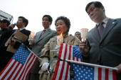 South Koreans participate in a candal light vigil to tribute the victims of the Virginia Tech University shootings April 18 2007 in Seoul South Korea...