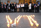 South Koreans participate in a candlelight vigil for the victims of one of the deadliest school shooting in US history outside a city hall in Seoul...