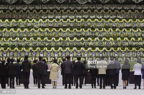 South Koreans pay tribute at a group memorial altar for victims of sunken passengers ship at the Ansan Olympic Memorial Hall on April 23 2014 in...