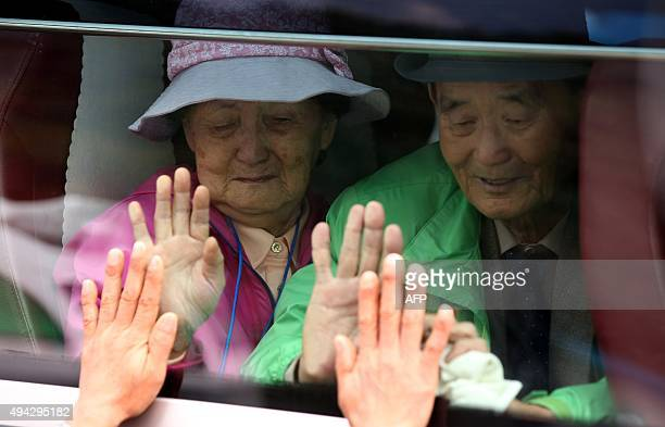 South Koreans react as they bid farewell through the window to their North Korean relatives after a threeday family reunion event at North Korea's...