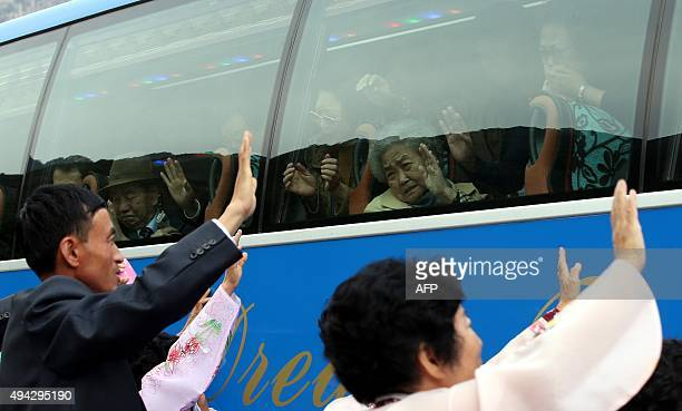 South Koreans react as they wave farewell through the window to their North Korean relatives after a threeday family reunion event at North Korea's...