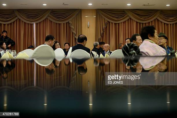 South Koreans selected to attend family reunions with the North attend an 'orientation' event the night before the meeting at a hotel resort in the...