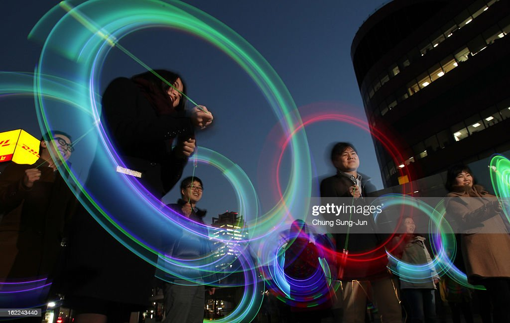 South Koreans spin illuminated cans during 'Cyber Jwibulnoli' at Everland on February 21, 2013 in Seoul, South Korea. Jwibulnoli is originally played on the first full moon of the lunar year, that is February 25 this year.