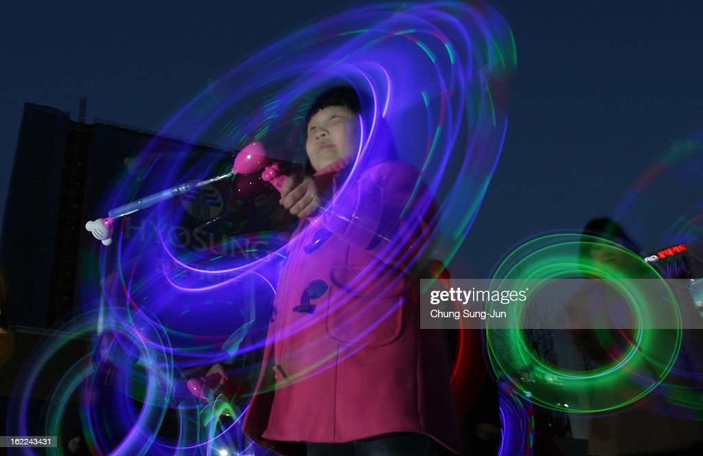 South Koreans spin illuminated sticks during 'Cyber Jwibulnoli' at Everland on February 21, 2013 in Seoul, South Korea. Jwibulnoli is originally played on the first full moon of the lunar year, that is February 25 this year.