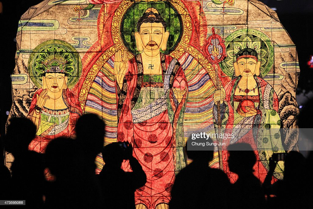 South Koreans walk beside colorful lanterns as they celebrate the forthcoming birthday of buddha on May 16 2015 in Seoul South Korea As the exact...