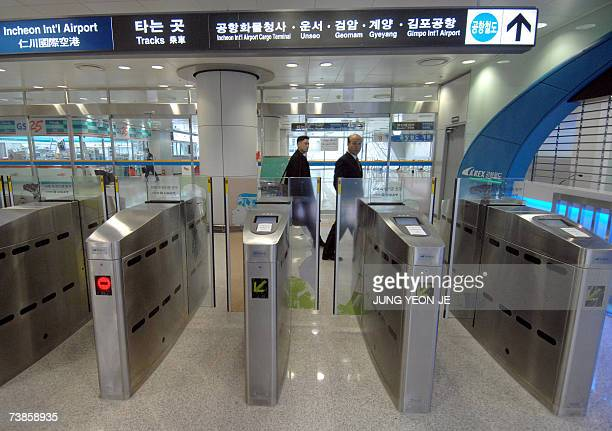 South Koreans walk past ticket gates at Incheon International Airport railroad station west of Seoul 22 March 2007 The railway linking Seoul to...