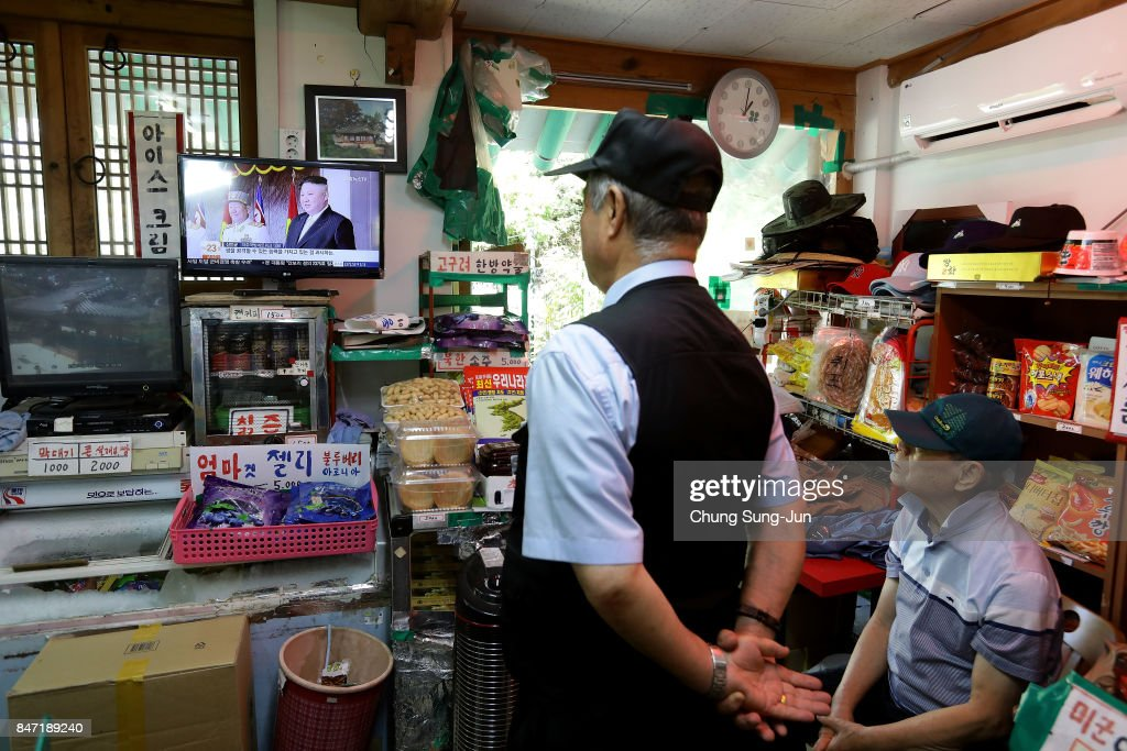 South Koreans watch a television broadcast reporting the North Korean missile launch at the their store, near the demilitarized zone of Panmunjom on September 15, 2017 in Paju, South Korea. North Korea launched a ballistic missile over Japan just days after the U.N. Security Council adopted new sanctions against the regime over its sixth nuclear test on Sept. 3.