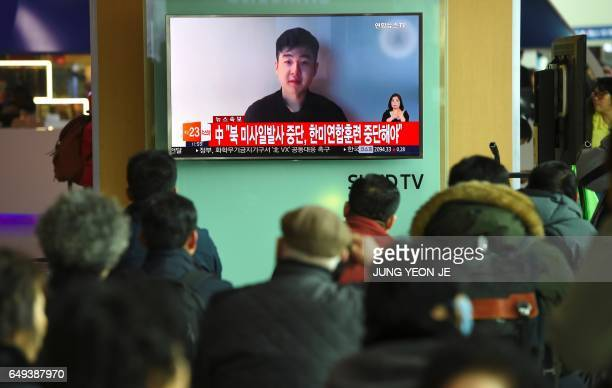 South Koreans watch a television news showing a video footage of a man who claims he is Kim HanSol a nephew of North Korea's leader Kim JongUn at a...