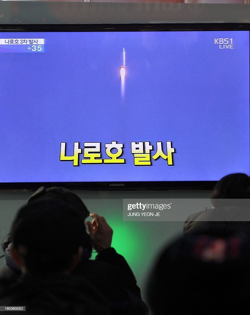 South Koreans watch live footage of South Korea's third attempt of a rocket launch on a television set at a railway station in Seoul on January 30, 2013 as the 140-tonne Korea Space Launch Vehicle (KSLV-I) blasted off at 4:00 pm (0700 GMT) from the Naro Space Center on the south coast. South Korea launched a rocket on January 30 in its third bid to put a satellite in orbit -- a high-stakes challenge to national pride after rival North Korea succeeded in the same mission last month.