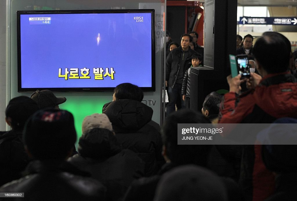 South Koreans watch live footage of South Korea's third attempt of a rocket launch on a television screen at a railway station in Seoul on January 30, 2013 as the 140-tonne Korea Space Launch Vehicle (KSLV-I) blasted off at 4:00 pm (0700 GMT) from the Naro Space Center on the south coast. South Korea launched a rocket on January 30 in its third bid to put a satellite in orbit -- a high-stakes challenge to national pride after rival North Korea succeeded in the same mission last month. AFP PHOTO / JUNG YEON-JE