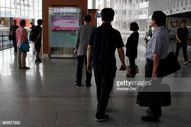 South Koreans watch TV news reporting the North Korea's nuclear test at the Seoul Railway Station on September 9 2016 in Seoul South Korea North...