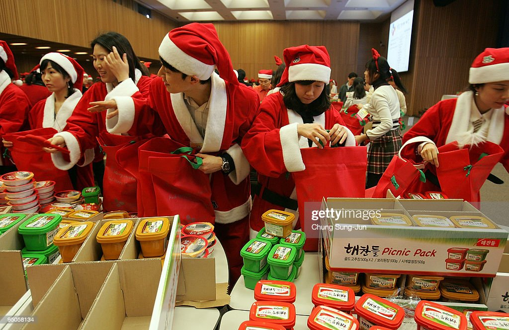 South Koreans wearing Santa Claus outfits prepare to wrap Christmas gifts  at the 'Santa factory