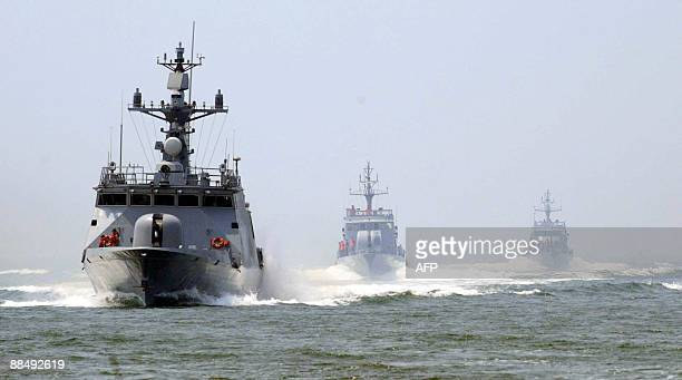 South Korea's 440ton highspeed missile ship the Yoon Young Ha is followed by patrol boats as it sails in the Yellow Sea off the southwestern port of...